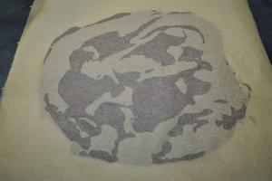 12) Ein 2. Backpapier darauf geben und glatt streichen